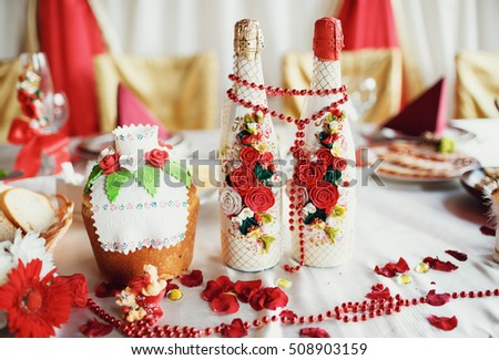 Two decorated bottles of champagne on the wedding celebration