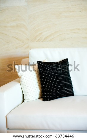 Two decorative pillows on a contemporary sofa. - stock photo