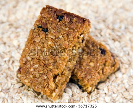 Two delicious fresh home-made flapjacks stacked together on a background of jumbo oats