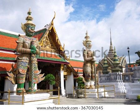 Two demons statue in the Grand Palace, Bangkok, Thailand. - stock photo