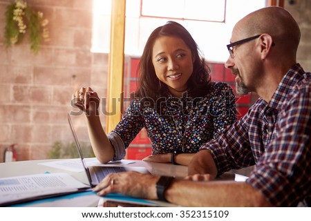 Two Designers With Laptop Meeting In Modern Office - stock photo