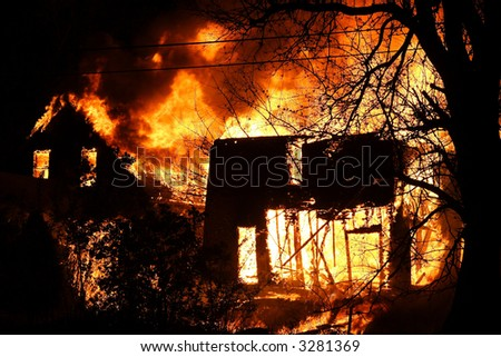 Two Detroit houses on fire during the night - stock photo