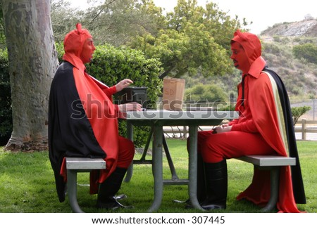 two devils eating lunch - stock photo