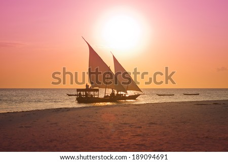 two dhows sailing in sunset - stock photo