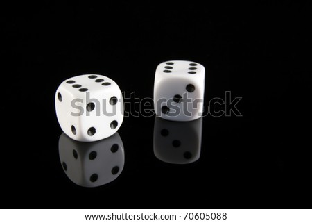 Two dice on a black background showing two sixes - stock photo