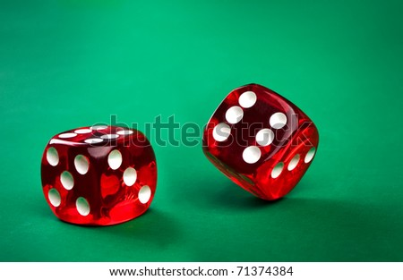 two dice on a green background - stock photo