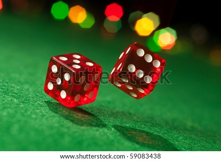 Two dice on casino table. Concept of gambling. Chance to luck - stock photo