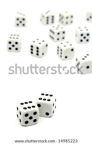 Two dice showing number six on white background - stock photo