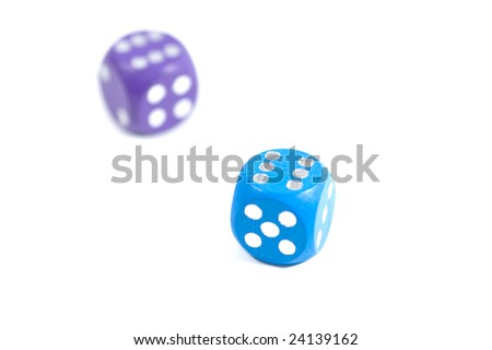 Two dices with six dots on white background. Shallow DOF - stock photo