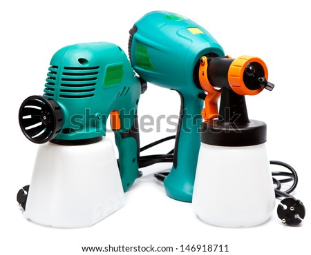 two different construction electrical spray gun for pulverization of color  - stock photo