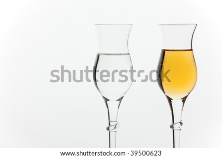 Two different kinds of italian grappa - stock photo