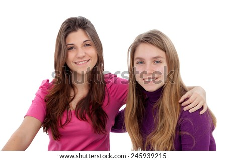 Two different sisters smiling isolated on a white background - stock photo