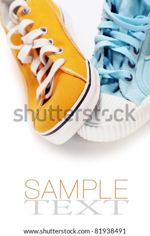 two different sport shoes over white (with sample text) - stock photo