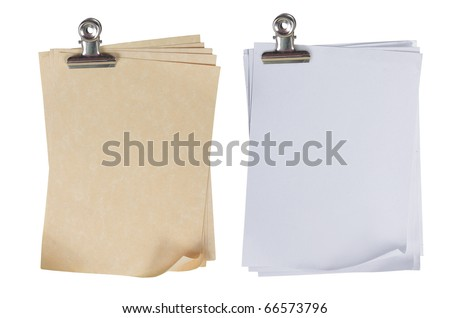 two different types of stack of paper attached with a paper clip - stock photo