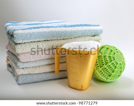 Two different ways of washing clothes, with detergent and a modern ball washer... - stock photo