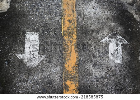 two direction arrow sign on grunge  floor