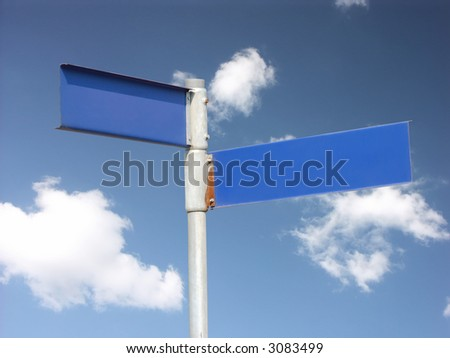 Two-directional blank metal signpost over blue sky