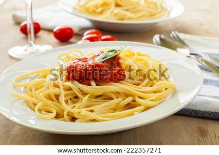 two dishes with spaghetti bolognesa on table - stock photo