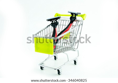 two disposable shaver  in shopping trolley isolated on white background - stock photo