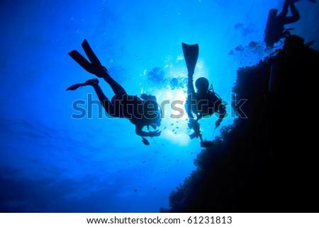 Two divers explore underwater world - stock photo