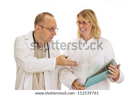 Two doctors are discussing about some documents - stock photo