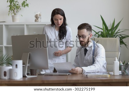 Two doctors discussing test results and working together - stock photo