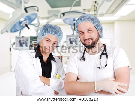 Two doctors in surgery room - stock photo