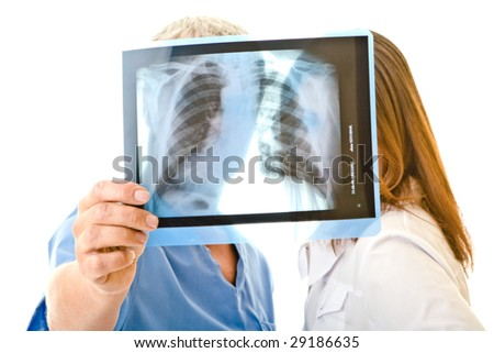 Two doctors look x-ray films - stock photo