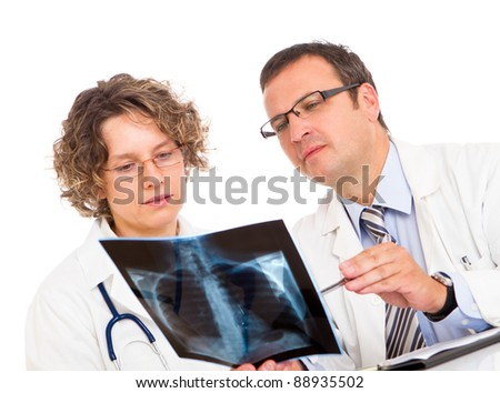 Two doctors looking an x-ray image - stock photo