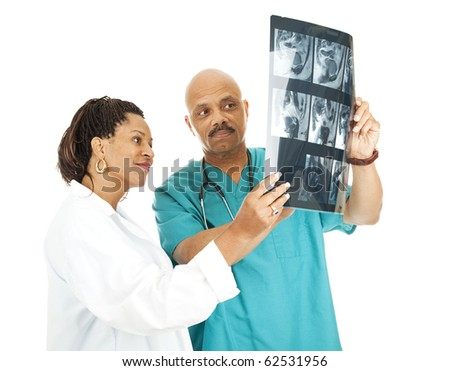 Two doctors reviewing a patient's x-ray results.  Isolated on white. - stock photo