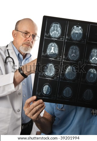 Two doctors viewing MRI Scans of Patient's Brain - stock photo