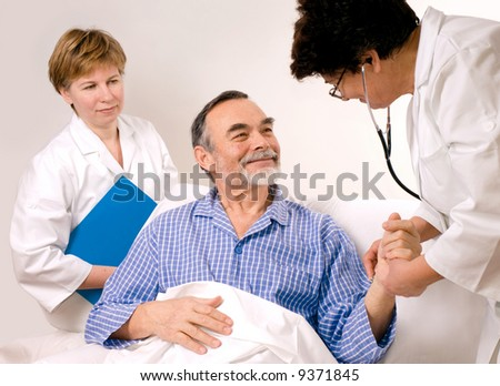 Two doctors with a patient