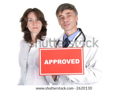 Two doctors with approved table. Your can change inscription. - stock photo