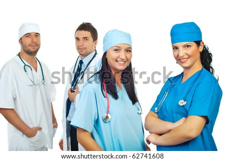 Two  doctors women in front of image smiling  and other two doctors men standing in background - stock photo