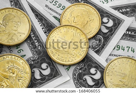 two dollar bills and one dollar coins - stock photo