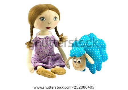 Two dolls girl and lamb - stock photo