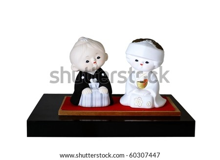 Two dolls of a Japanese bride and groom in wedding outfits - stock photo