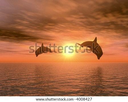 two dolphins floating at ocean - stock photo