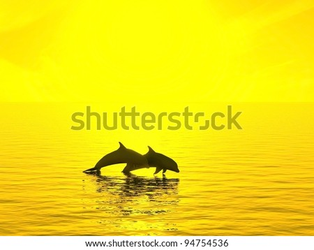 Two dolphins floating at ocean on sunset - stock photo