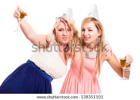 Two drunken women celebrate with alcohol, isolated on white background - stock photo