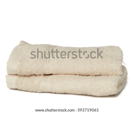Two dry bright fabric towels isolated on white background.