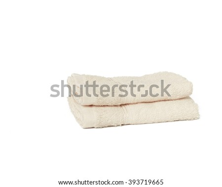 Two dry bright fabric towels isolated on white background with copyspace. - stock photo
