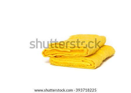Two dry bright fabric yellow towels isolated on white background with copyspace. - stock photo