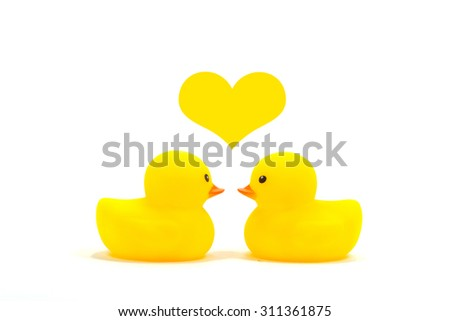 two duck face off together with one one yellow heart to be show love  - stock photo