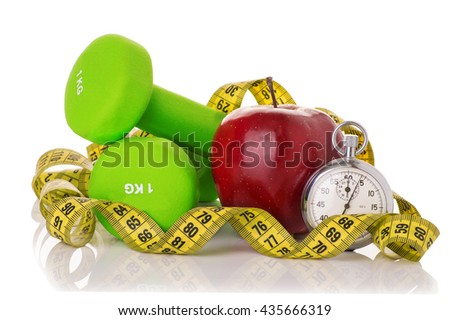 Two dumbbells, red apple, measuring tape and a stopwatch isolated on white background. Diet concept.