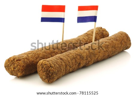 "Two Dutch snacks called ""fricandel"" with Dutch flag toothpicks on a white background - stock photo"