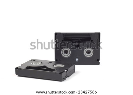 two DV cassettes, one standing upright, one lying down - stock photo