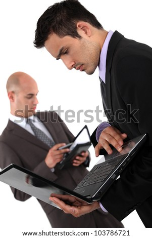 Two dynamic businessmen - stock photo
