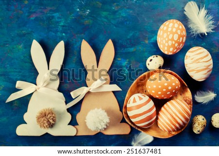Two Easter bunny and  easter eggs on a blue background - stock photo