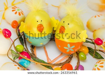 Two Easter chicken sitting together - stock photo